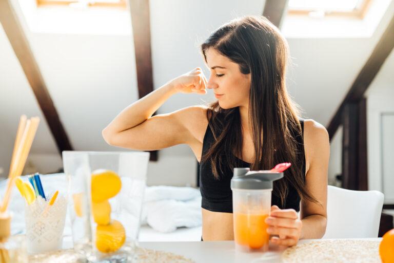 Woman,At,Home,Drinking,Orange,Flavored,Amino,Acid,Vitamin,Powder.keto